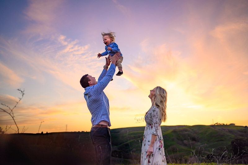 Family Photography, Father throwing little boy into the air